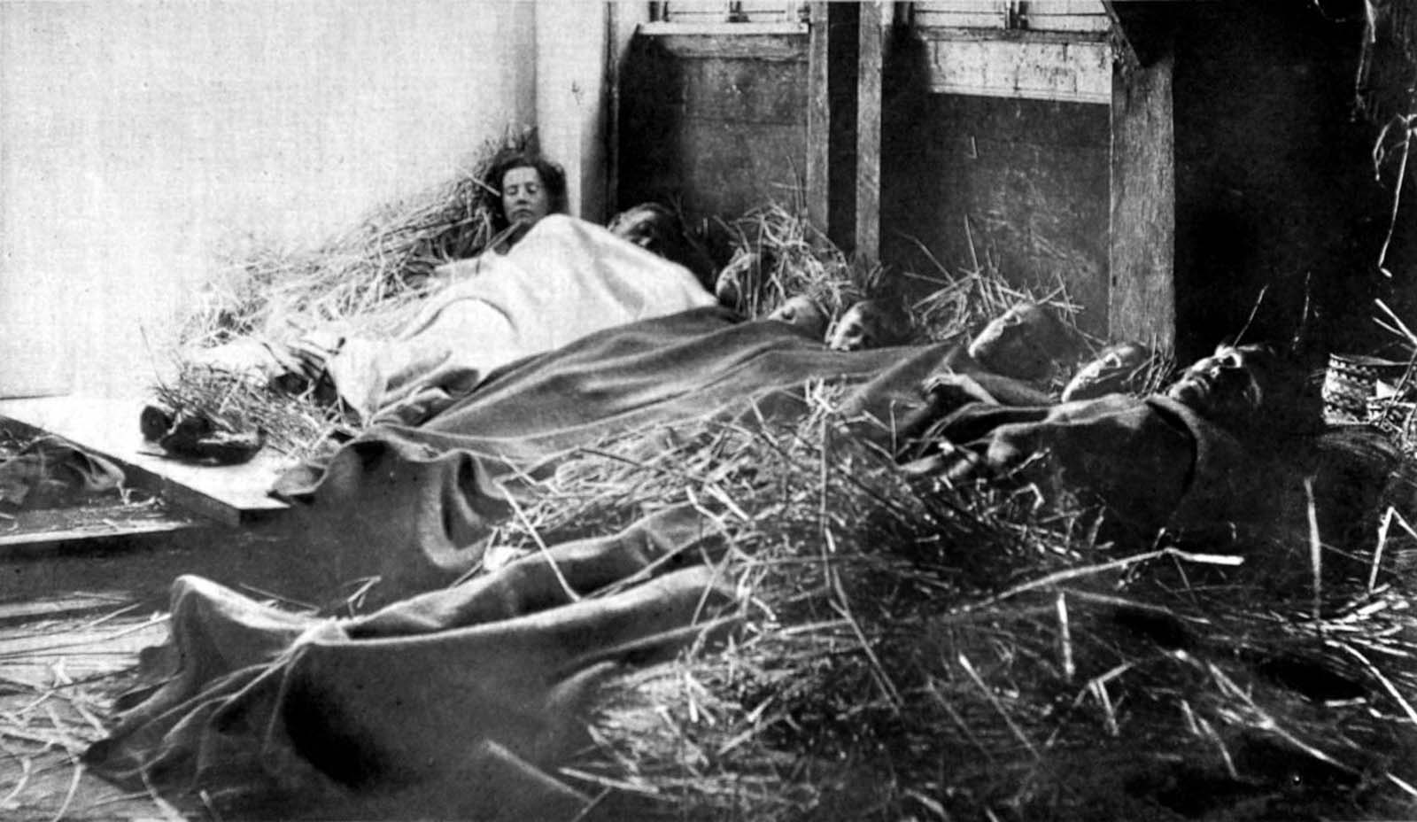 Belgian refugees sleep in a barn in France on Christmas Eve. 1914.