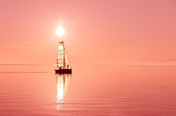 Boat On The Sea During Sunset