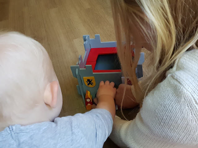 Sisters playing with the wooden castle