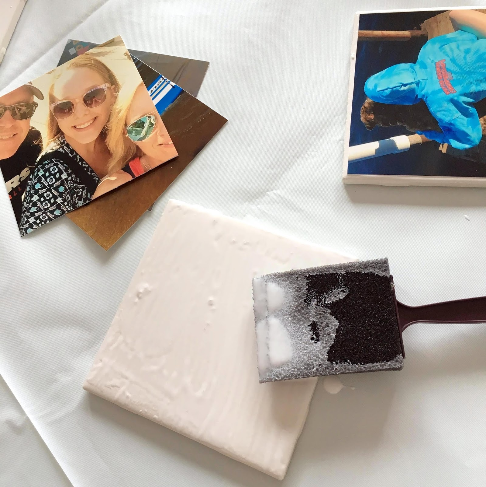 To personalize your coasters, layer Mod Podge over the top of the photo using even strokes.