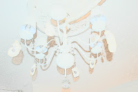 A common chandelier made over into a modern and chic light fixture,Fernando & Johanna
