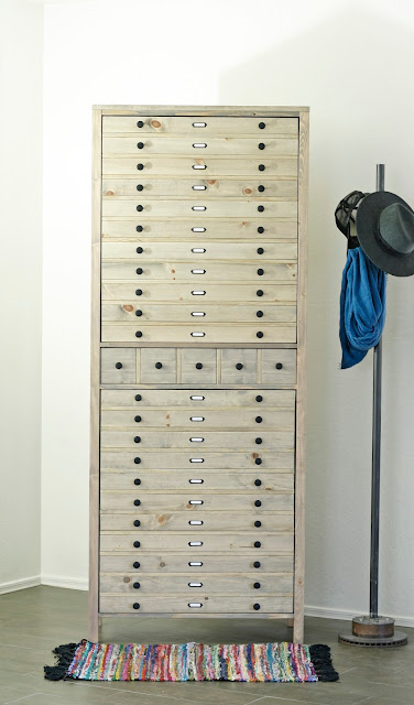 Learn how to build a large, printmaker's style cabinet with free building plans.