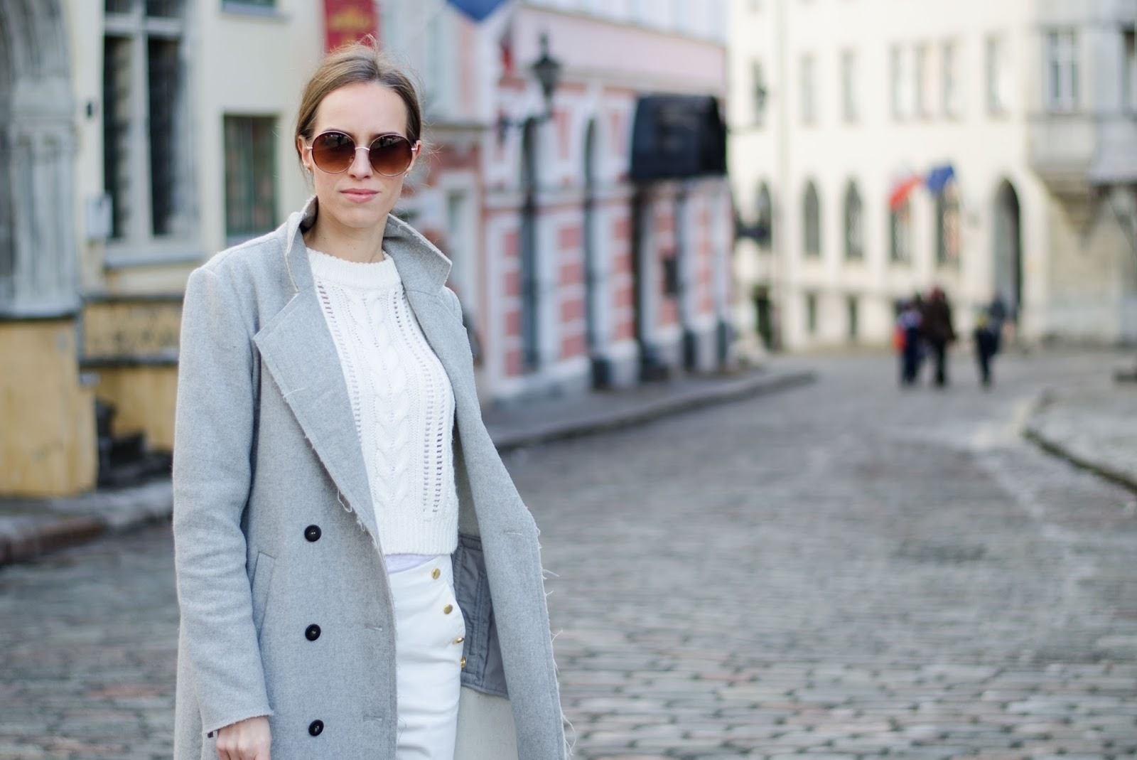 kristjaana mere minimalist spring look gray wool coat white sweater round sunglasses