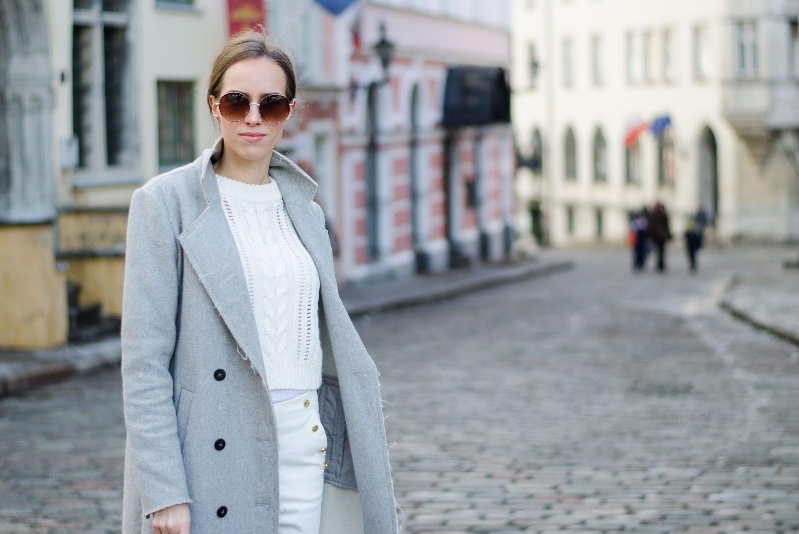 kristjaana mere minimalist spring look gray wool coat white sweater round sunglasses