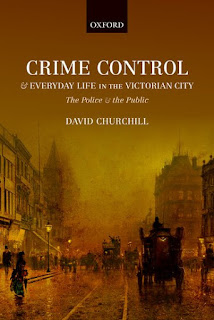 Book cover showing a Victorian painting of a city street, a coach and horses, numerous figures on a busy street, buildings on either side extending into the foggy distance. Book title reads: Crime Control & Everyday Life in the Victorian City: The Police & the Public [by] David Churchill. Publisher heading: Oxford [University Press].