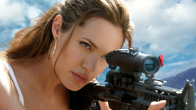 angelina-jolie-with-gun-in-movie-wallpaper