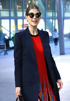 Rosamund Pike in Red Dress at London's Heathrow Airport