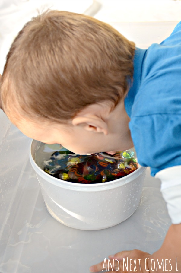 Water sensory play for toddlers and preschooelrs with glass stones from And Next Comes L