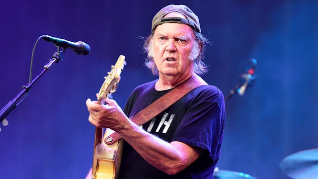 NEIL YOUNG HINTS TRUMP SHOULD BE ASSASSINATED OR REMOVED BY A COUP
