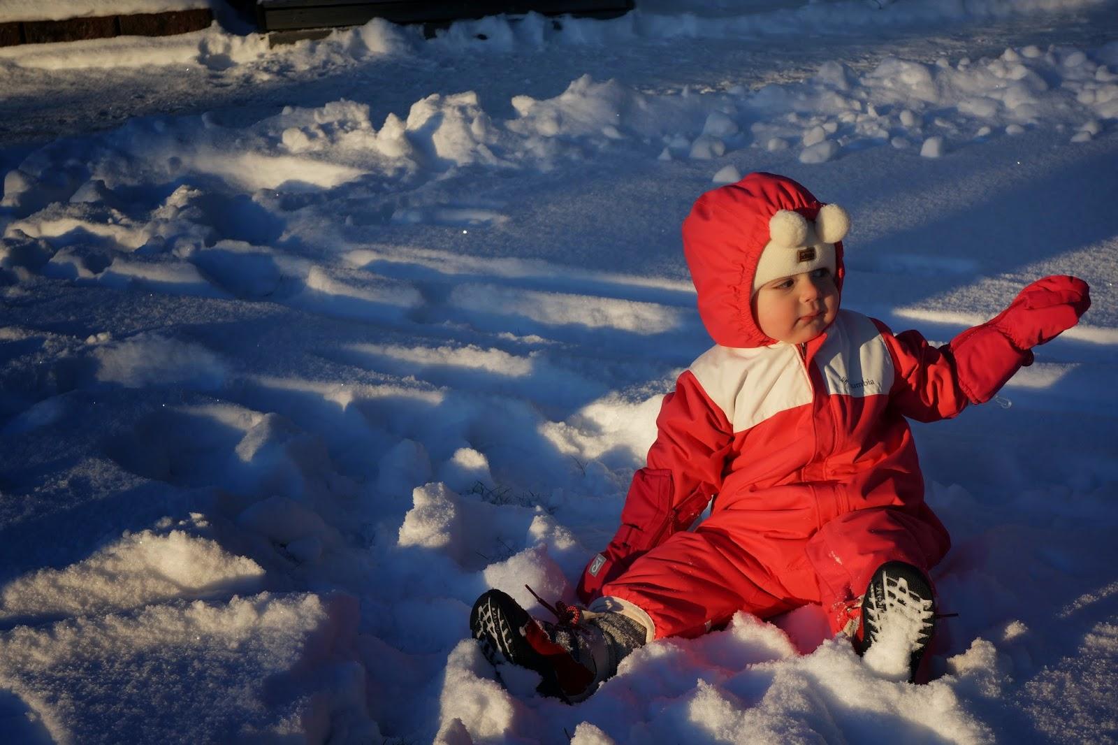 toddler sitting in snow