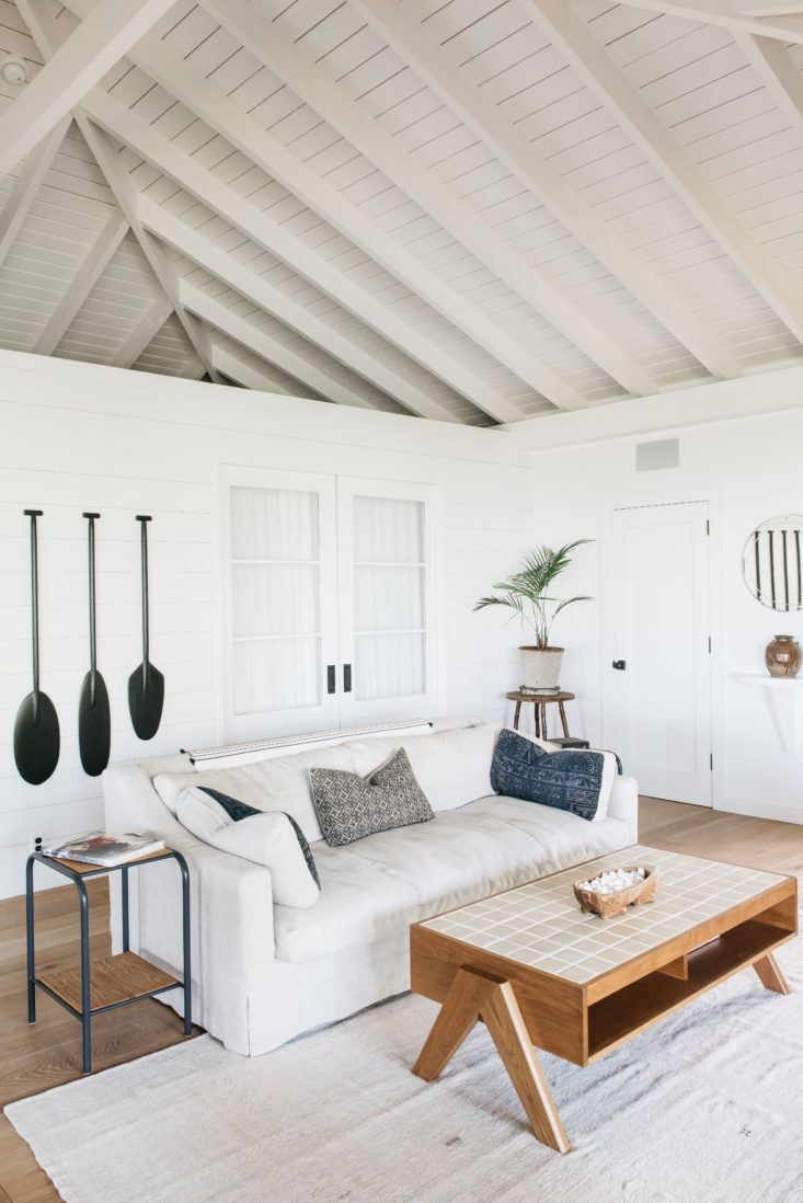 Gorgeous modern white living room in beautiful oceanfront cottage on Maui - found on Hello Lovely Studio