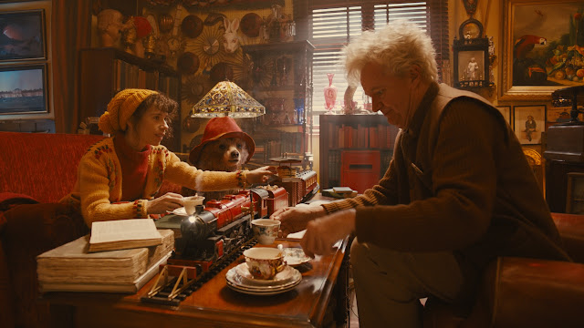 Paddington Sally Hawkins as Mrs. Brown, Paddington & Jim Broadbent as Mr. Gruber