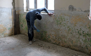 Okhtay scraping away at the walls