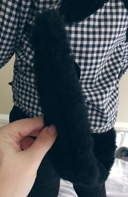 Tail sewn on to shirt