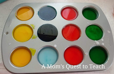 Muffin tin with water & baking soda mix