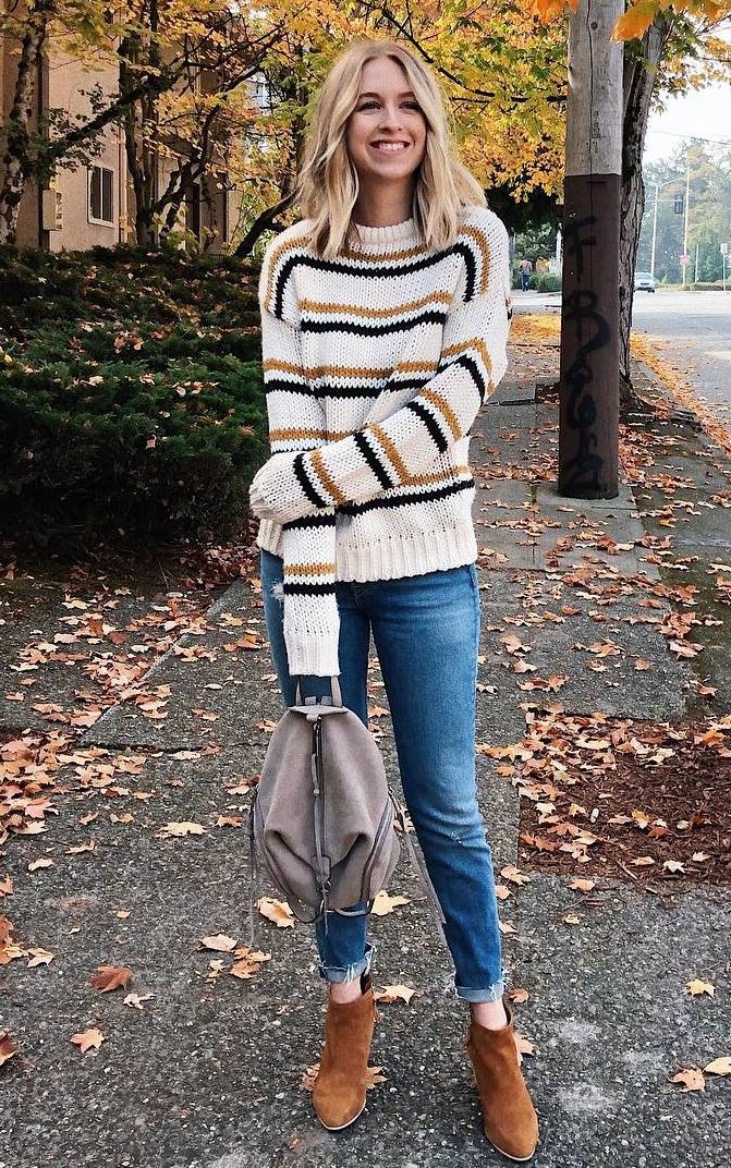 casual winter outfit / printed knit sweater + backpack + jeans + boots