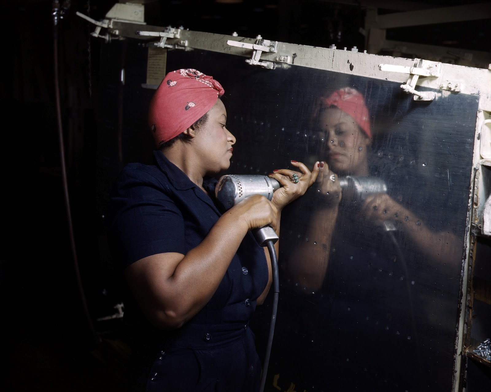 real-life Rosie the Riveter operating a hand drill at Vultee ...