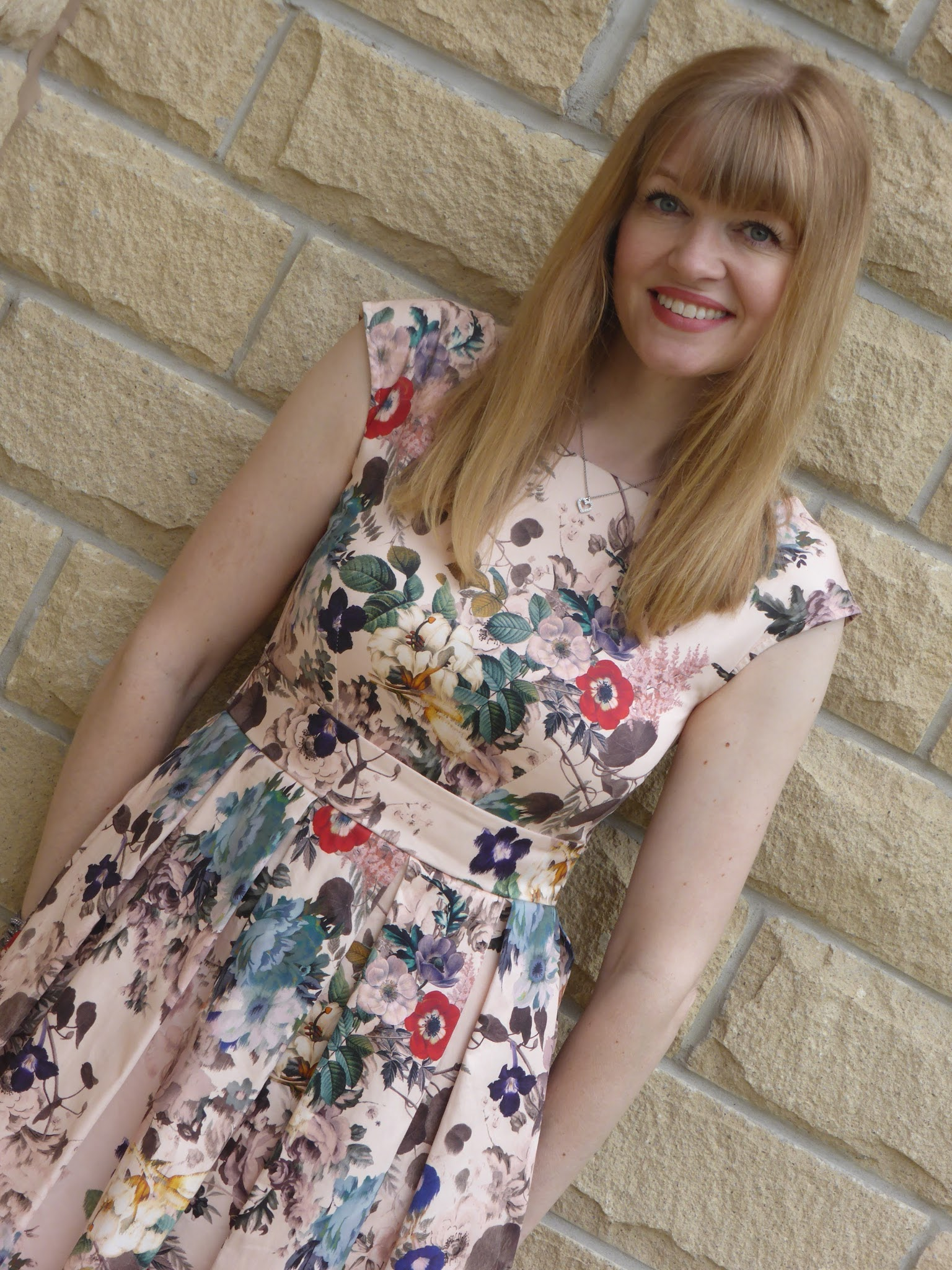 Over 40s blogger What Lizzy Loves wears floral skater dress with rose gold sandals