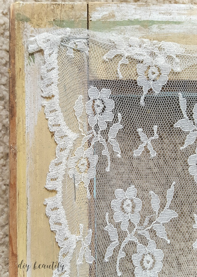 staple lace to window