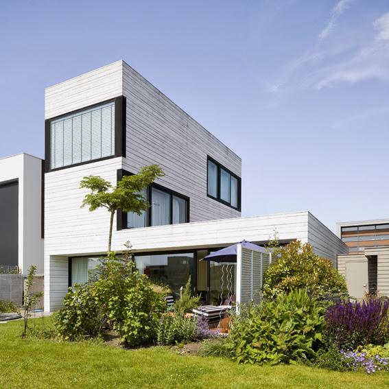 5255fe38e8e44e67bf000732_urban-villa-pasel-kuenzel-architects_02_pasel_kuenzel_ijb122