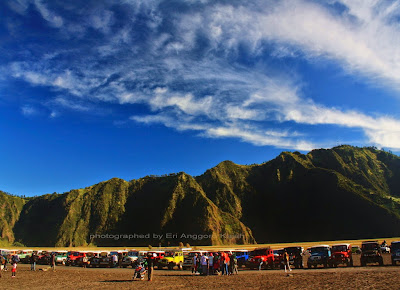 Jeeps and motor cycle park in Bromo's caldera