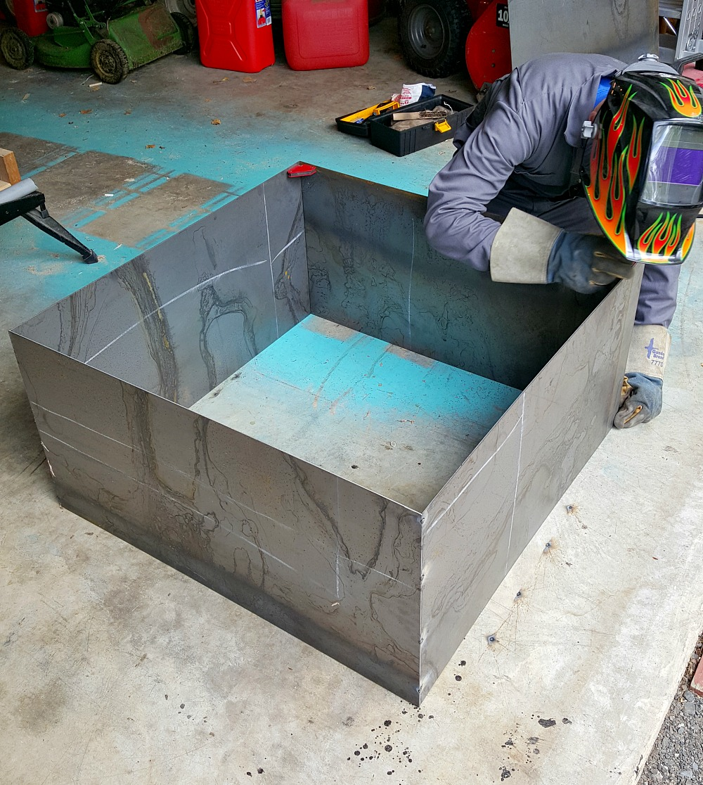 Modern diy welded fire pit our fire pit makeover dans for Modern fire pit ideas