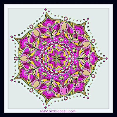 beautiful mandala coloured in greens pinks and golds