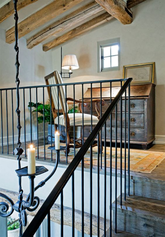 Is it a stairway to heaven? This lofty space with rustic elegance and country charm is a but one moment in this story brimming with interior design inspiration for admirers of European inspired country decor. #loft #rusticdecor