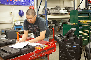 Chris Converse works on a test during his GM Automotive Service Educational Program class at UAA. (Photo by Philip Hall/University of Alaska Anchorage)