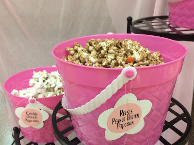 Everyone loves Popcorn, and throwing together a quick popcorn bar is the perfect dessert treat for any occasion. But when the girls are getting together, we need a little bit of fluff and a lot of food.  Check out this quick and easy Popcorn bar using items you probably already own!
