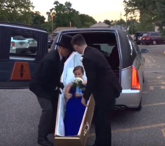 High school student arrives junior prom in a casket (video/photos)
