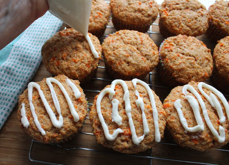 Food Lust People Love: hese delicious carrot muffins have all the flavor of tender carrot cake but are made with the two-bowl method traditional for muffins and are topped with generous lashing of sweetened cream cheese.