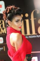 Apoorva in a Stunning Tight Leg Split Sleeveless Red Gown at IIFA Utsavam Awards 15.JPG