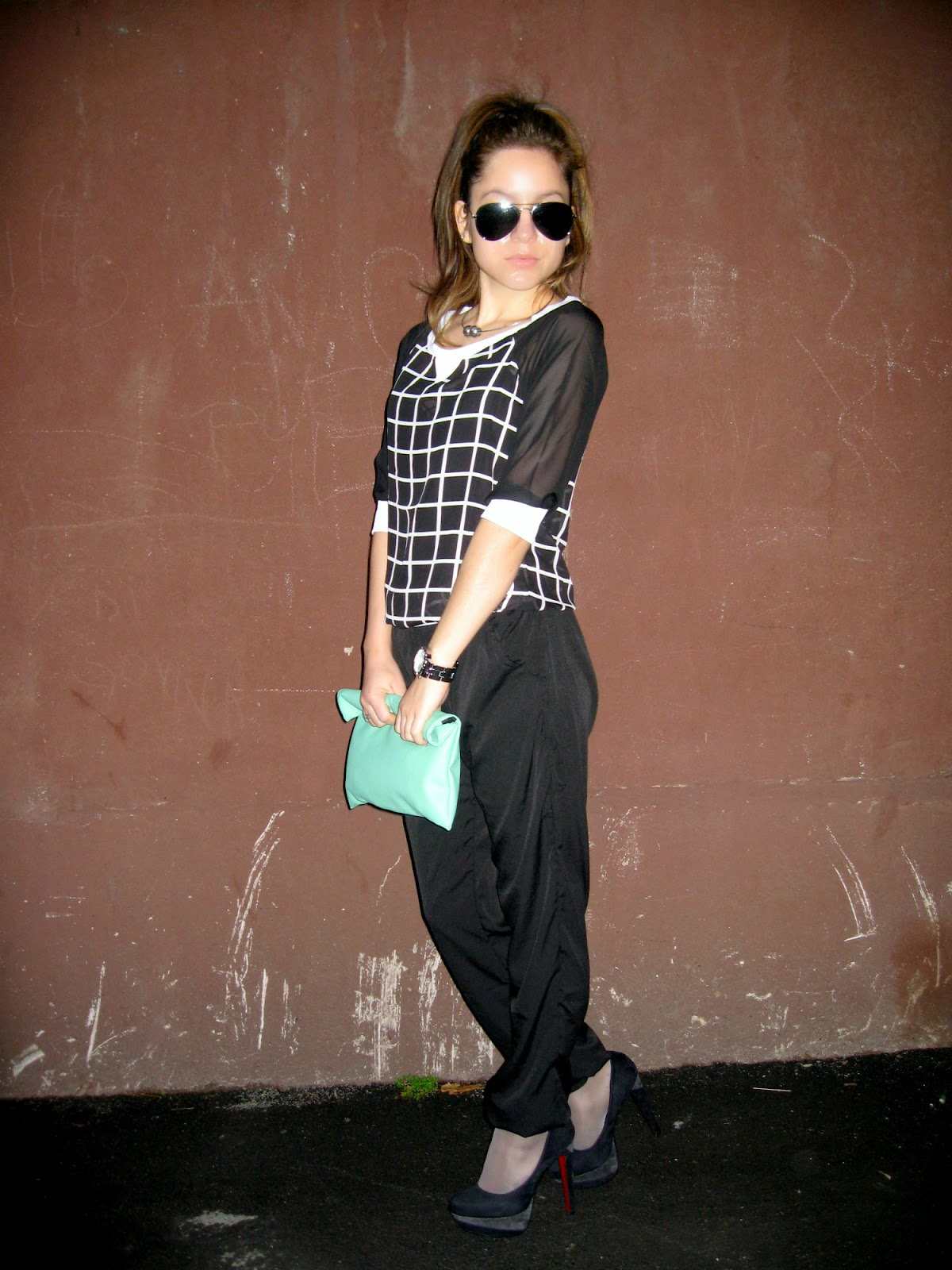 outfit, mint clutch, black pants, grid print top, gingham style check print top, black pumps, all black outfit look
