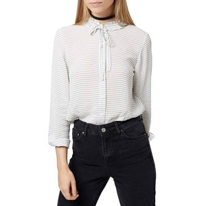 Topshop's ruffle neck blouse