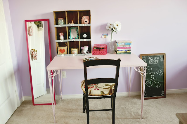 Girls bedroom update with retro style pink desk and reupholstered antique chair