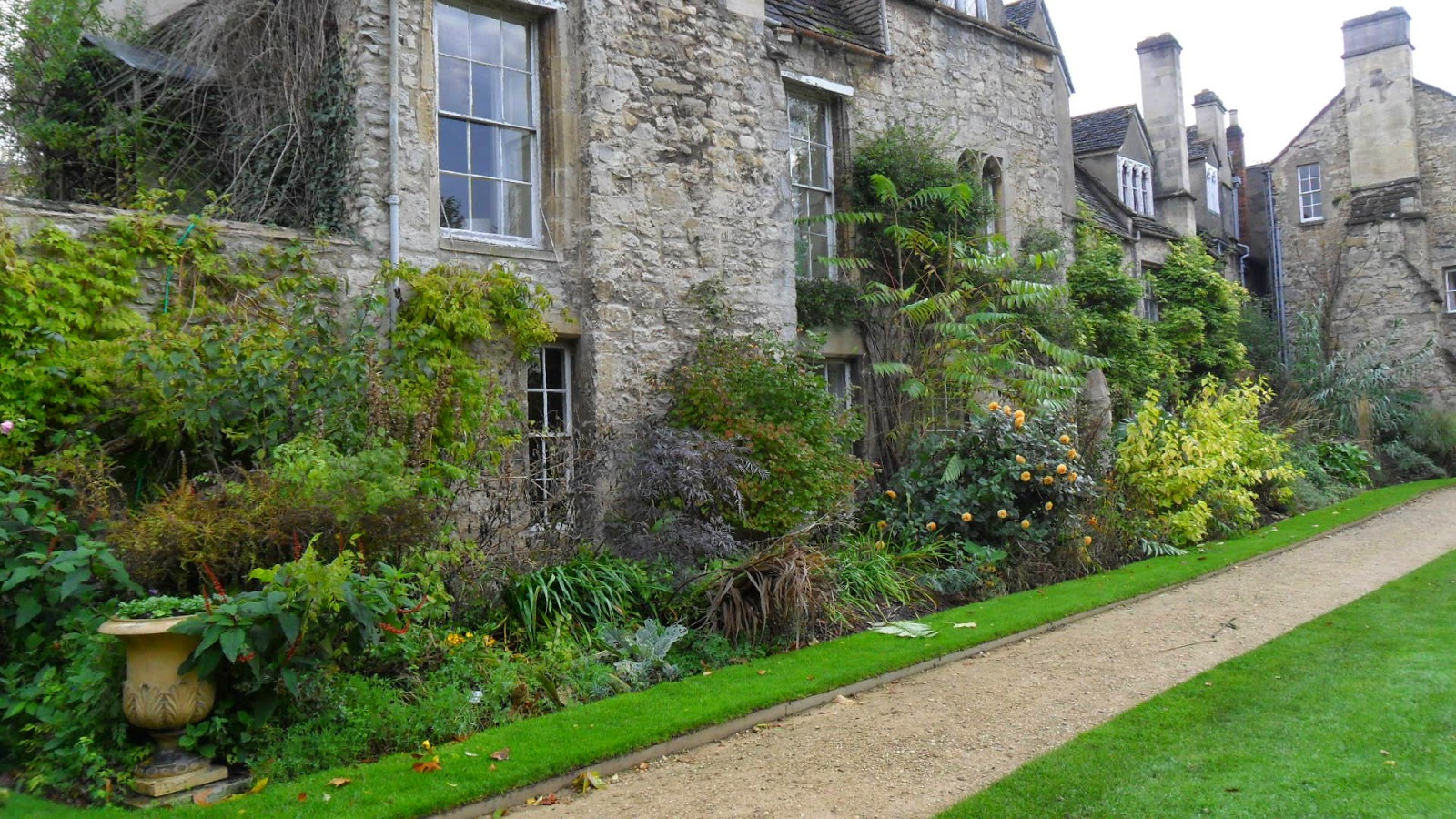 Worcester College Gardeners Cutting Down The Herbaceous
