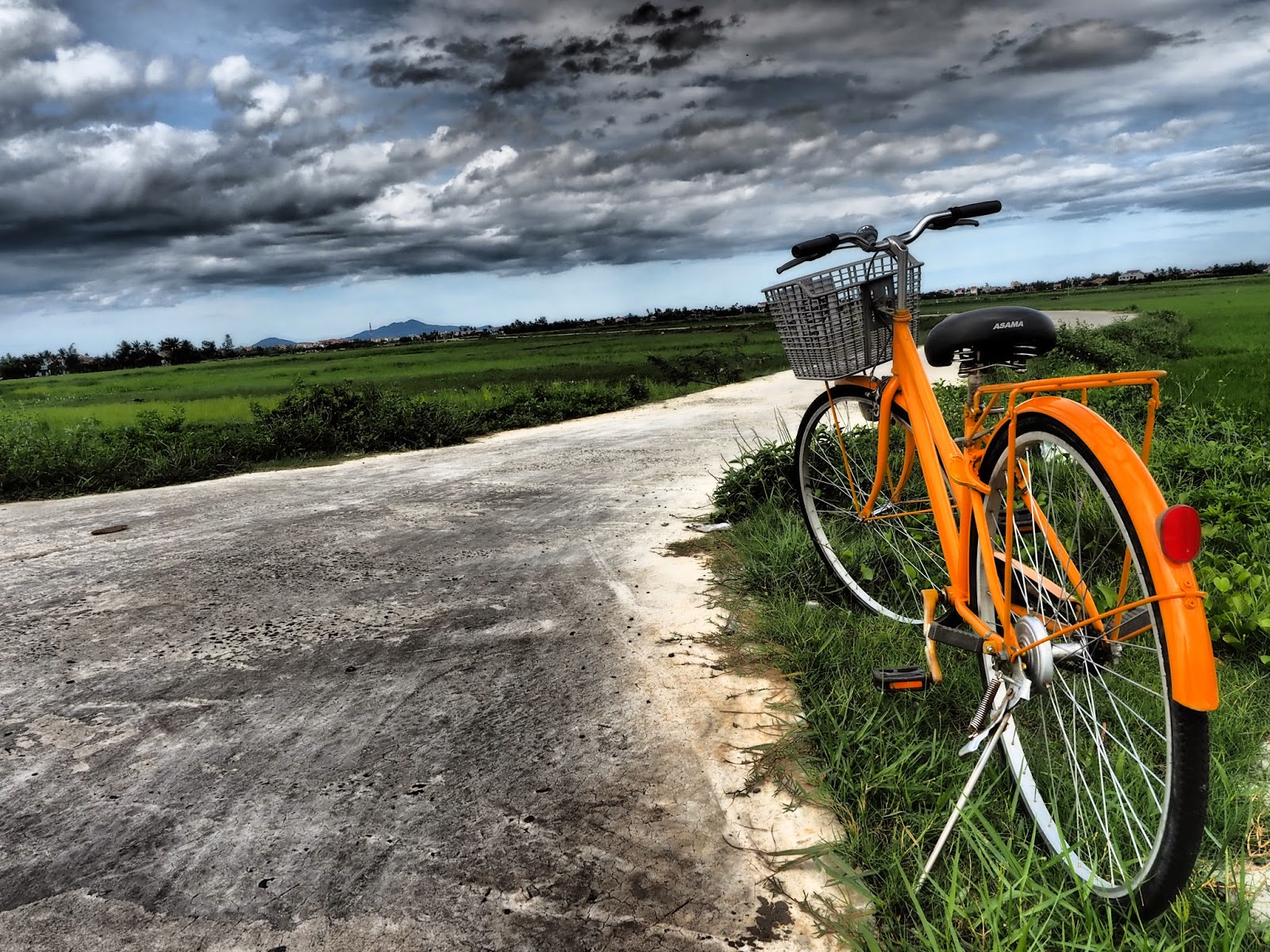 Riding bike bicycle Hoi An Vietnam UNESCO World Heritage roads travel holiday vacation trip