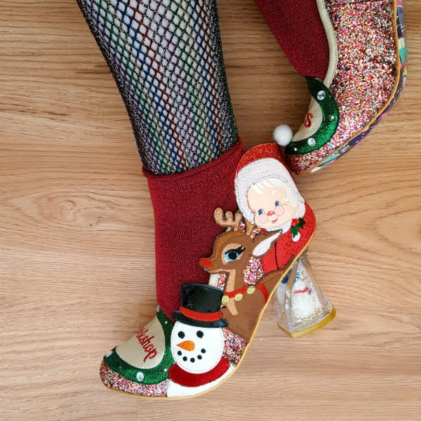 glitter christmas shoes on feet with rainbow fishnet tights and red sparkling socks