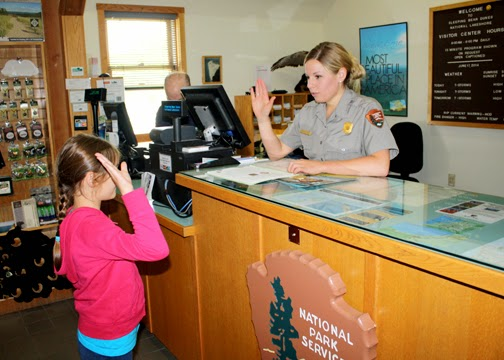 Tessa completed the final step in becoming a Sleeping Bear Dunes National Lakeshore Junior Ranger by reciting a pledge to protect and tell others about the park.