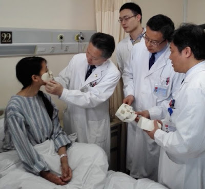China's surgeons grow new mouth, nose for woman on her chest
