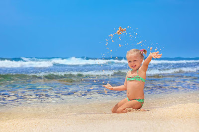 Waves-Beach-Little-girlbaby-enjoying-touch-of-sand