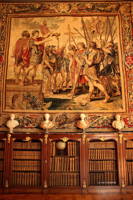 Strasbourg Palais Rohan. Tapestry, books and statues in the Library