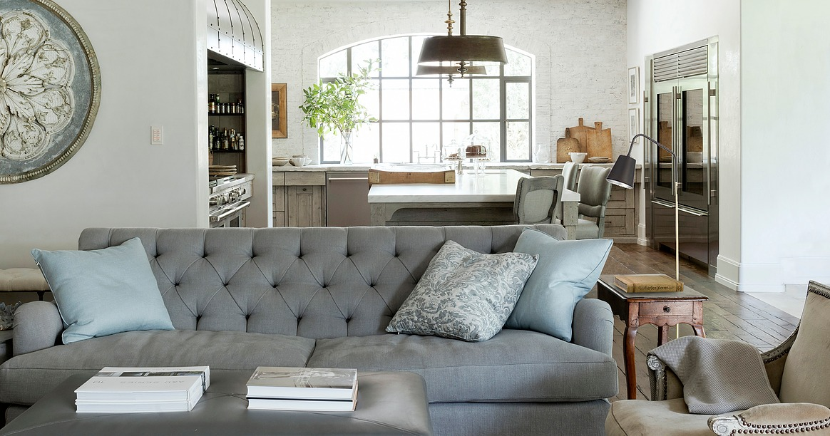 Living room kitchen blue sofa modern farmhouse Eleanor Cummings