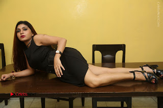 Tollywood Upcoming Actress Pooja Roshan Stills in Black Short Dress at Plus 1 Movie Trailer Launch  0365.JPG