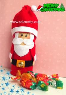 Santa-claus- reciclando- rollos-papel-higienico