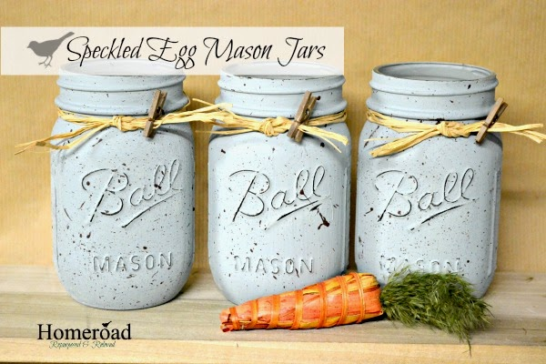 Three speckled mason jars with carrot