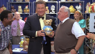 30 Rock screen shot of Alec Baldwin holding a cookie jar