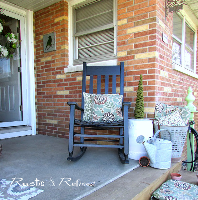 Spring decorating on the front porch using rustic and industrial decor