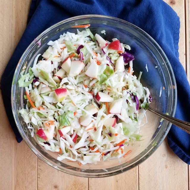 bowl of shredded cabbage and chopped apple slaw